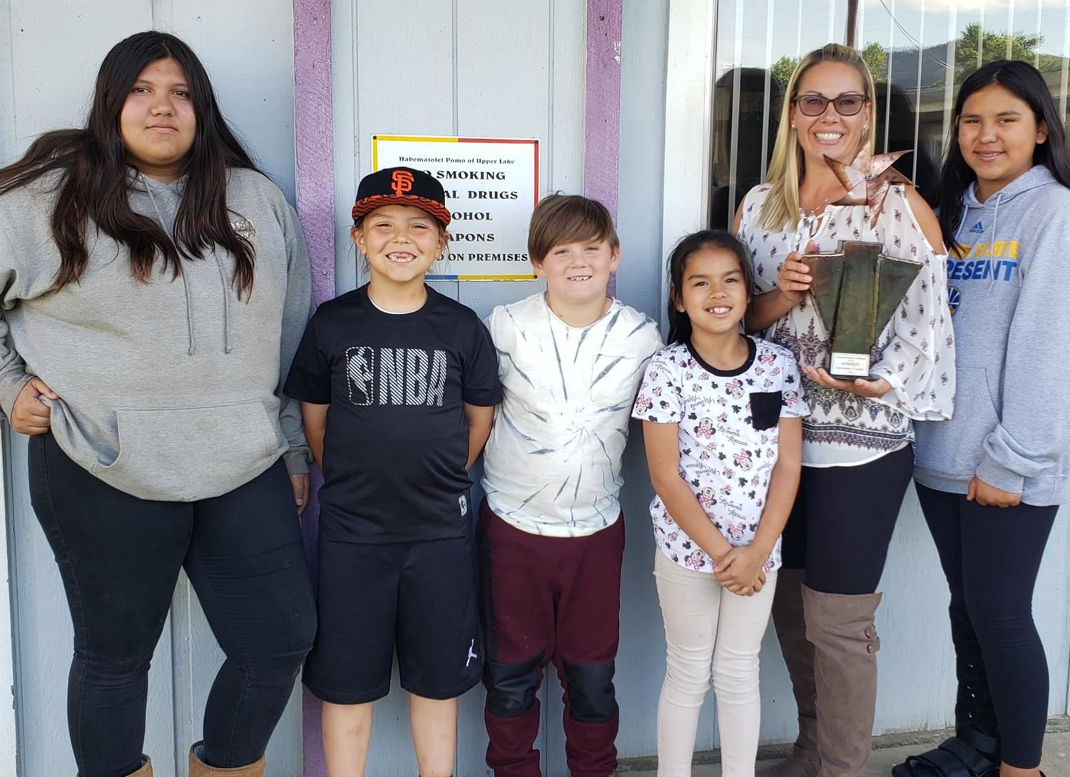 Students from Habematolel Education Center accept trophy.
