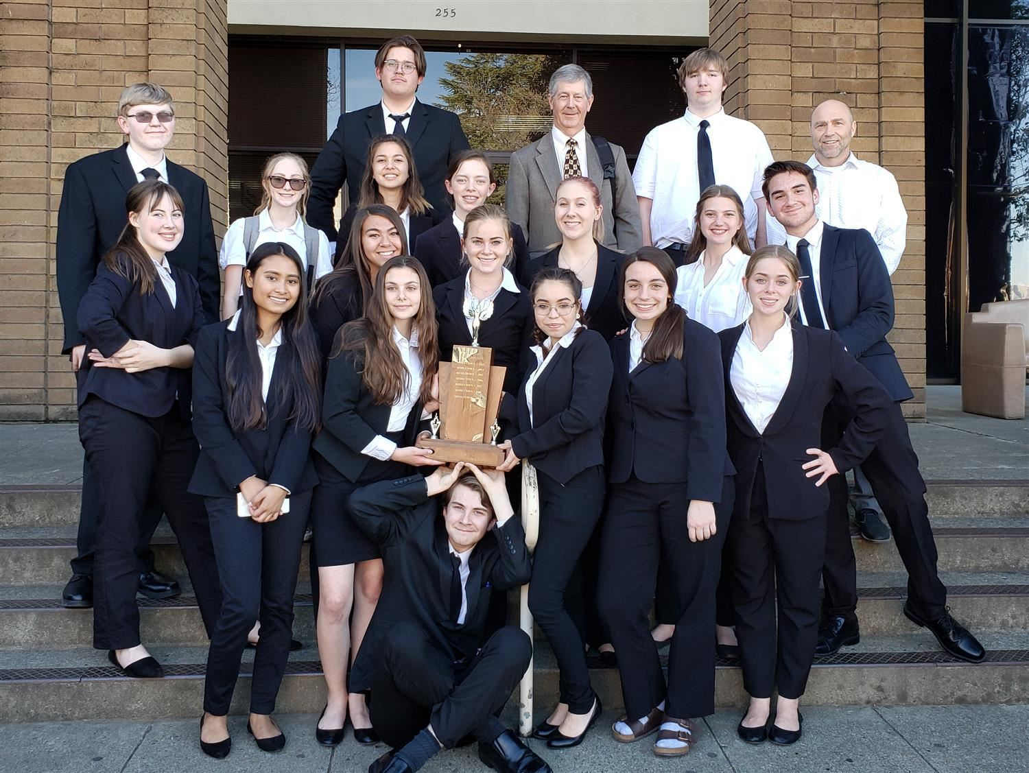 Middletown High School Mock Trial teams poses with trophy in front of the Lake County Courthouse.
